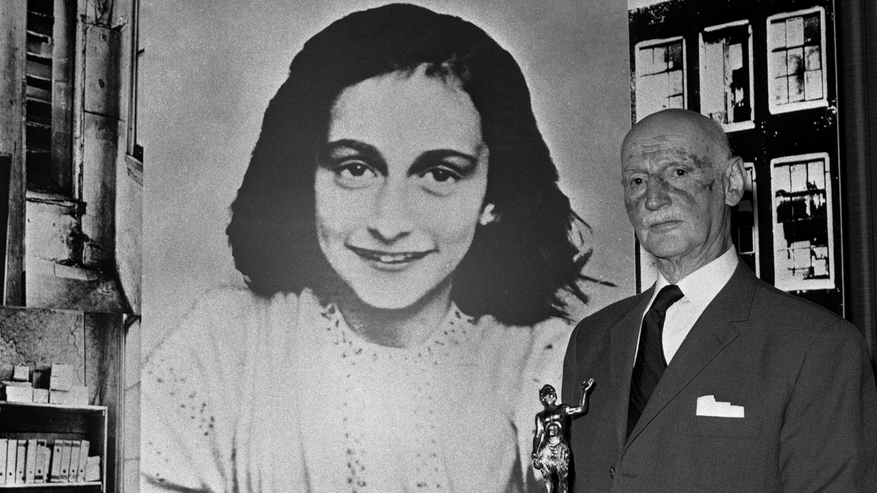 In this Monday, June 14, 1971 photo Dr. Otto Frank holds the Golden Pan award, given for the sale of one million copies of the famous paperback The Diary of Anne Frank.