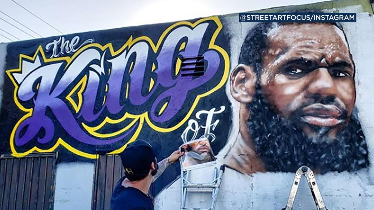 A large mural of the Lakers newest superstar, LeBron James, is going up on the side of a Venice restaurant.