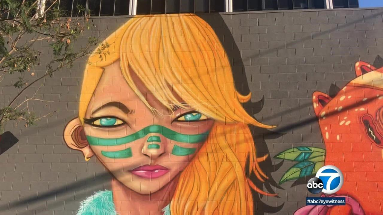 The Bixby Knolls Improvement Association brought in Seattle-based street artist Ten Hundred to lend his talents to a blank gray wall.