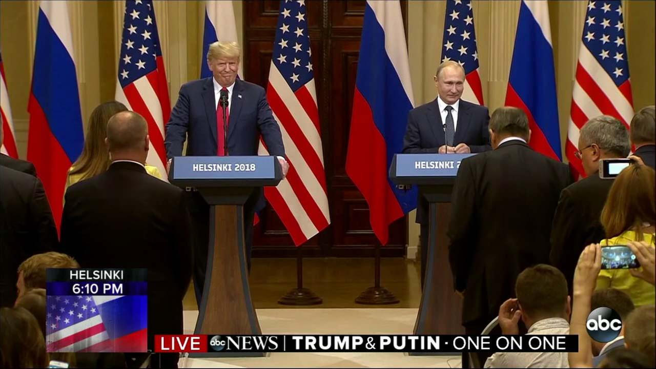 President Donald Trump and Russian President Vladimir Putin stand at the podium before a joint press conference in Helsinki, Finland, Monday, July 16, 2018.