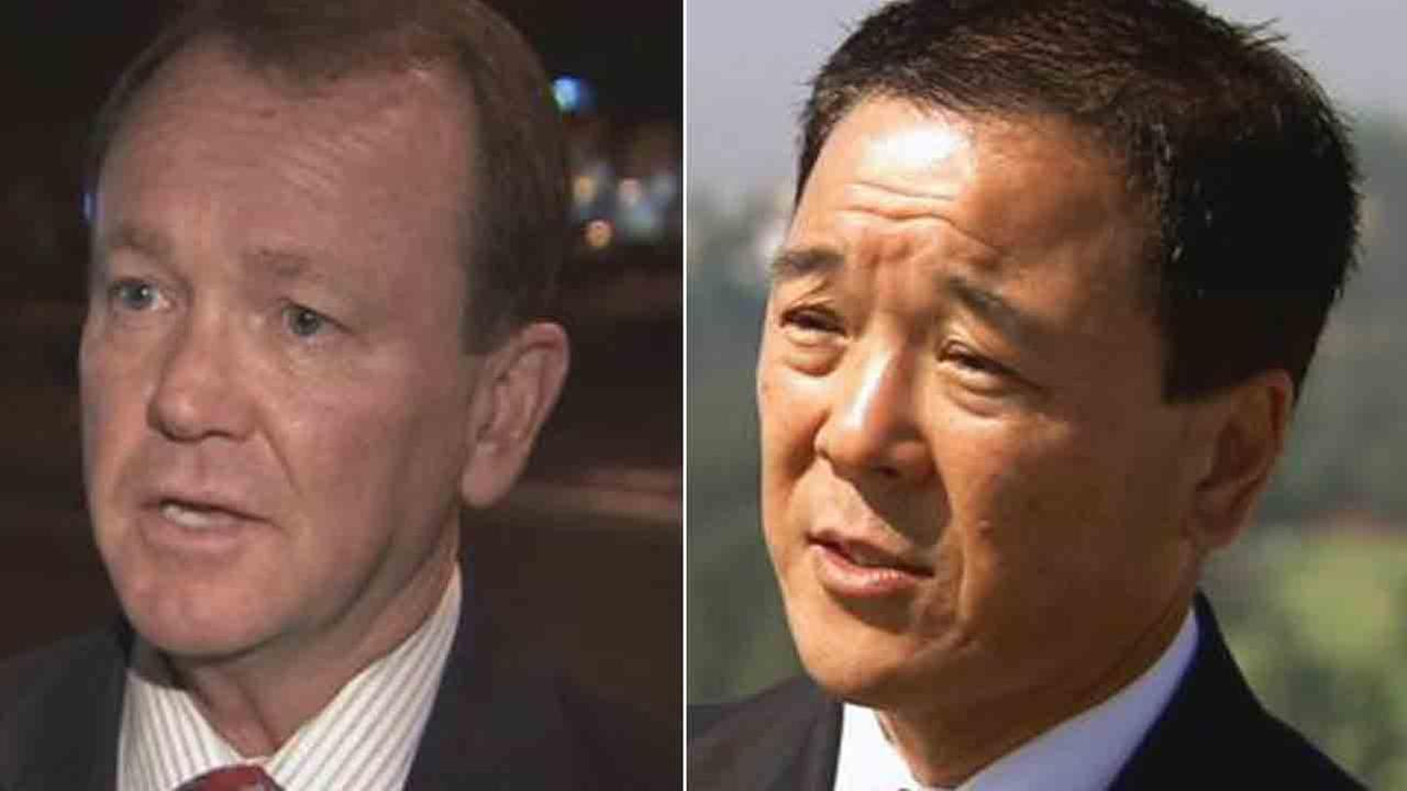 Jim McDonnell (left) defeated former Undersheriff Paul Tanaka in the LA County sheriffs race.