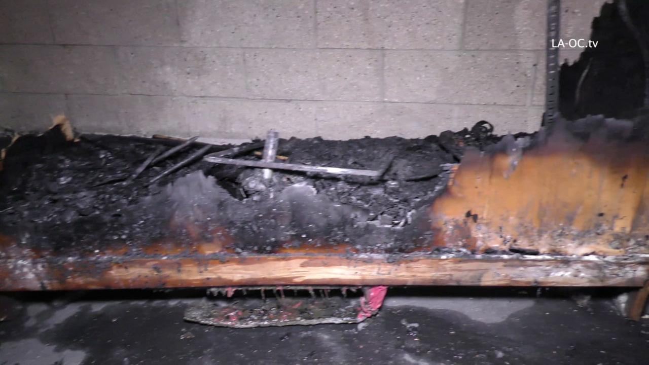 A burned piece of wood is shown at Mission Viejo High School in file photos.
