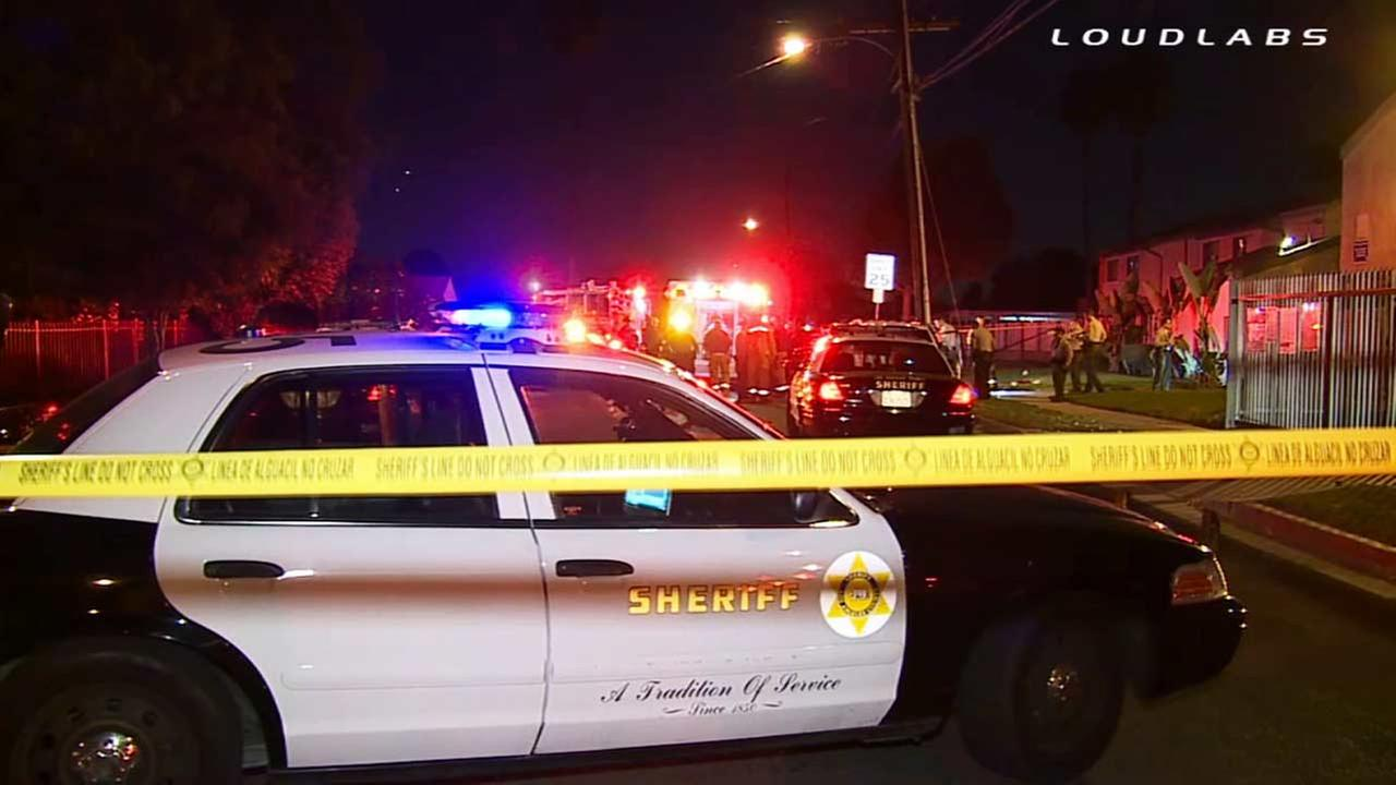 Crime tape ropes off the scene of a shooting on the 1200 block of Compton Avenue in Willowbrook on Friday, Nov.7, 2014.