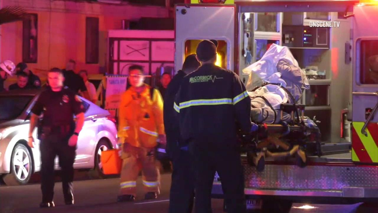 Paramedics placed a man wounded in a shooting in Gardena in a stretcher. The suspect who shot him was charged on Friday.