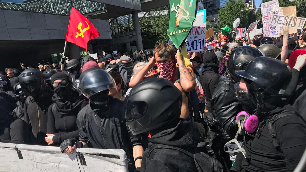 A right-wing group and self-described anti-fascist counter-protesters rallied in Portland, Oregon, Saturday, Aug. 4, 2018.