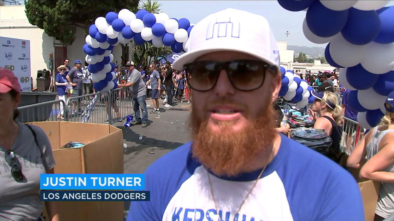 Justin Turner worked with Dodgers teammate Clayton Kershaw to hand out school supplies to Los Angeles children on Saturday, Aug. 4, 2018.