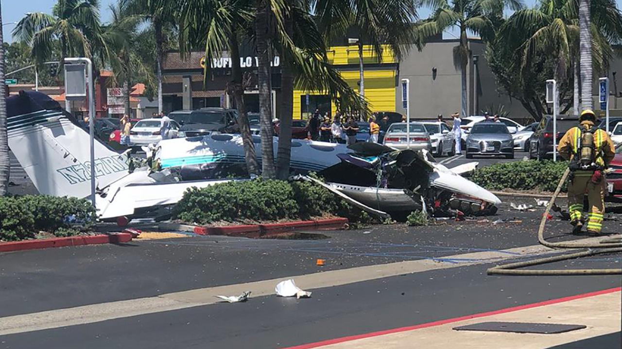 Five dead as plane crashes into shopping centre auto  park in California