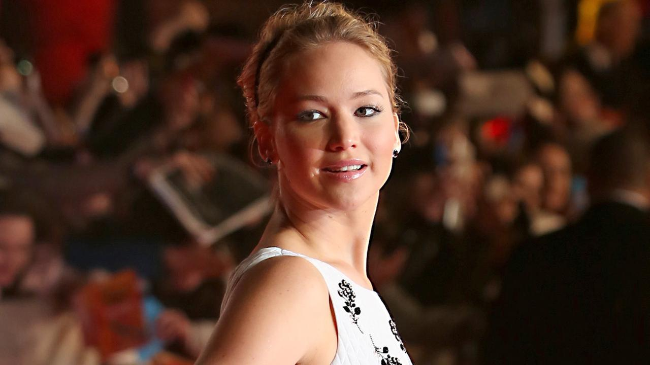 Jennifer Lawrence poses for photographers upon arrival to the world premiere of The Hunger Games: Mockingjay Part 1 in London, Monday, Nov. 10, 2014.