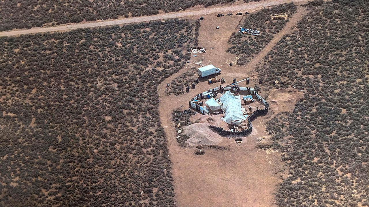 FILE - This Aug. 3, 2018, file photo released by Taos County Sheriffs Office shows a rural compound during an unsuccessful search for a missing boy in Amalia, N.M.