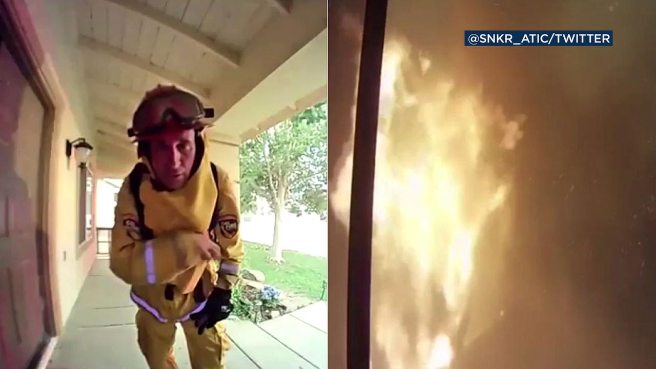 A man in Corona evacuated his house due to the Holy Fire, but he watched remotely from a security camera as the fire came dangerously close to his home.