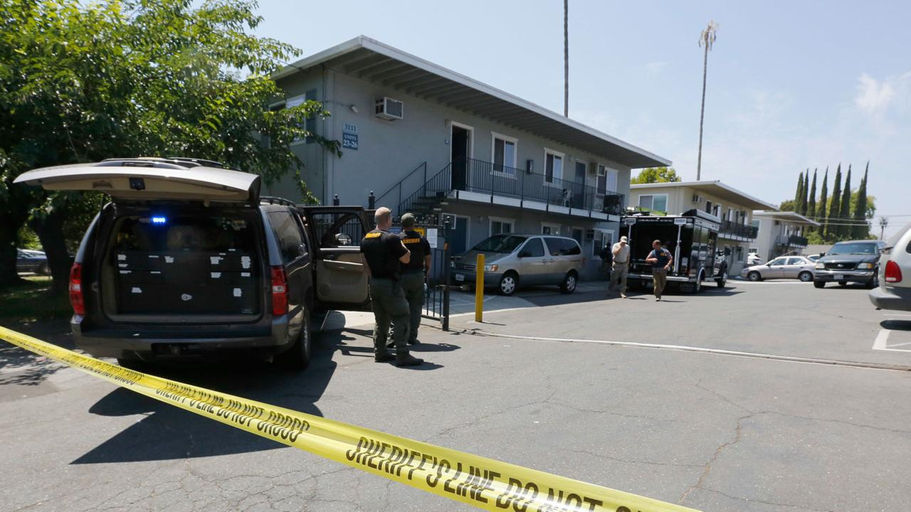 Crime scene tape blocks the entrance to an apartment complex following the arrest of a 45-year-old Iraqi refugee, Omar Ameen, Wednesday, Aug. 15, 2018, in Sacramento, Calif.