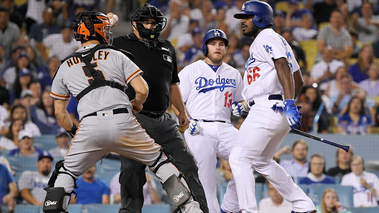 A shoving match between the Dodgers Yasiel Puig (right) and Giants catcher Nick Hundley escalated into a bench-clearing brawl on Aug. 14, 2018 at Dodger Stadium.