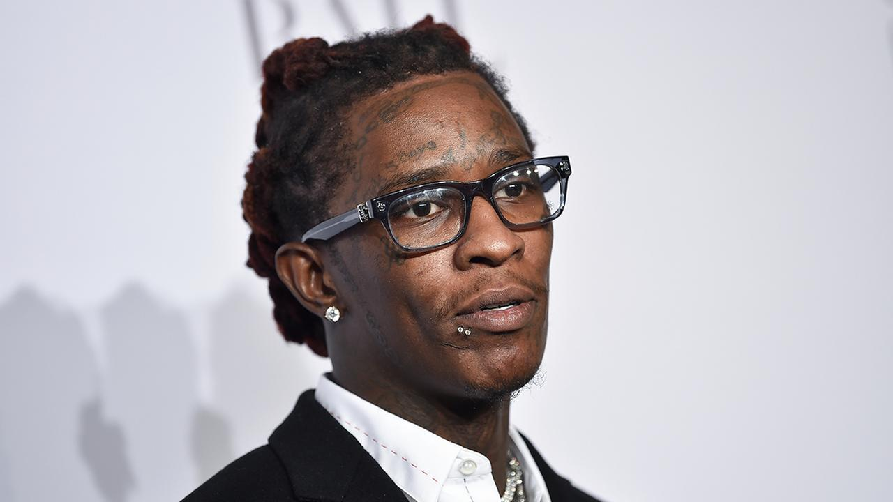The rapper known as Young Thug was arrested while celebrating his 27th birthday and the release of his latest album at a Dave and Busters in Hollywood, authorities said.