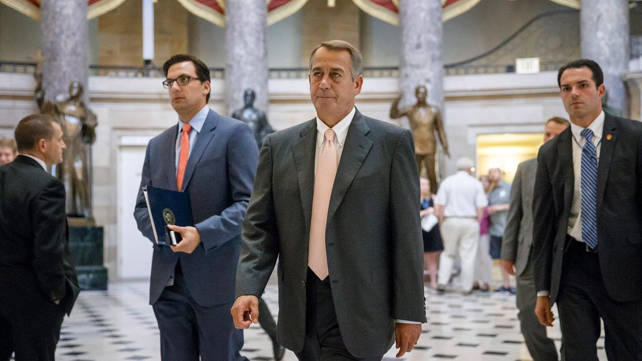 In this July 30, 2014 file photo, Speaker of the House John Boehner, R-Ohio, strides to the chamber as lawmakers prepare to move on legislation against President Obama.