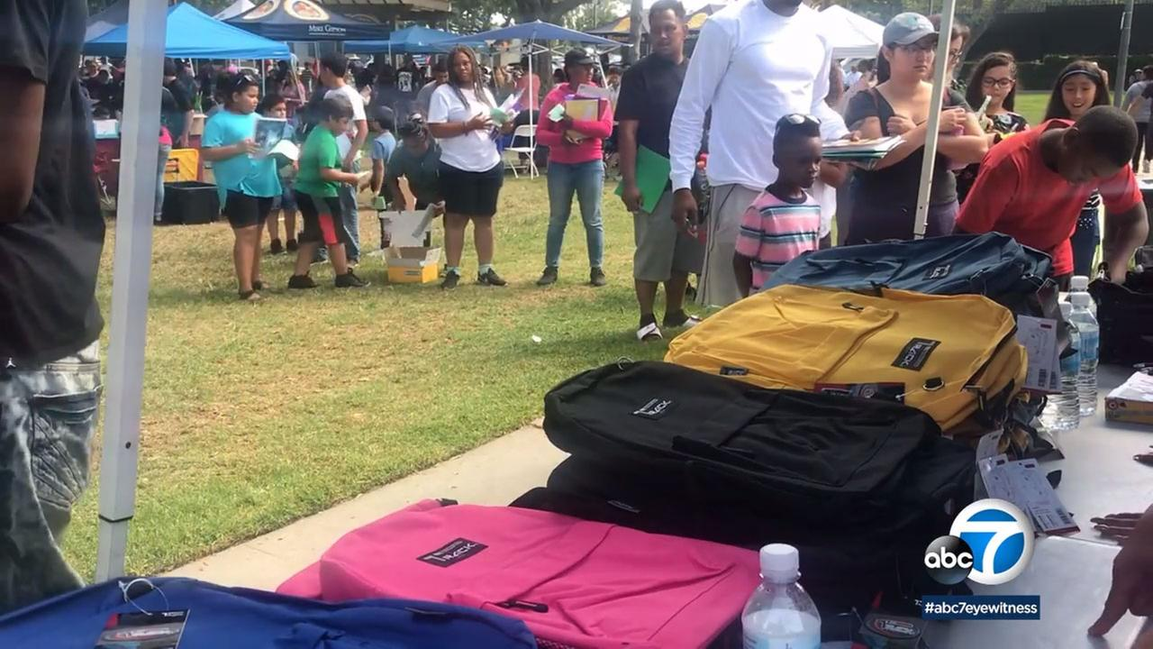 Long lines stretched through Scherer Park in Long Beach for a giveaway of 1,000 backpacks.
