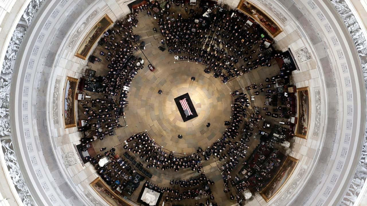 The flag-draped casket of Sen. John McCain, R-Ariz., lies in state on the Lincoln Catafalque in the Rotunda of the U.S. Capitol, Friday, Aug. 31, 2018, in Washington.