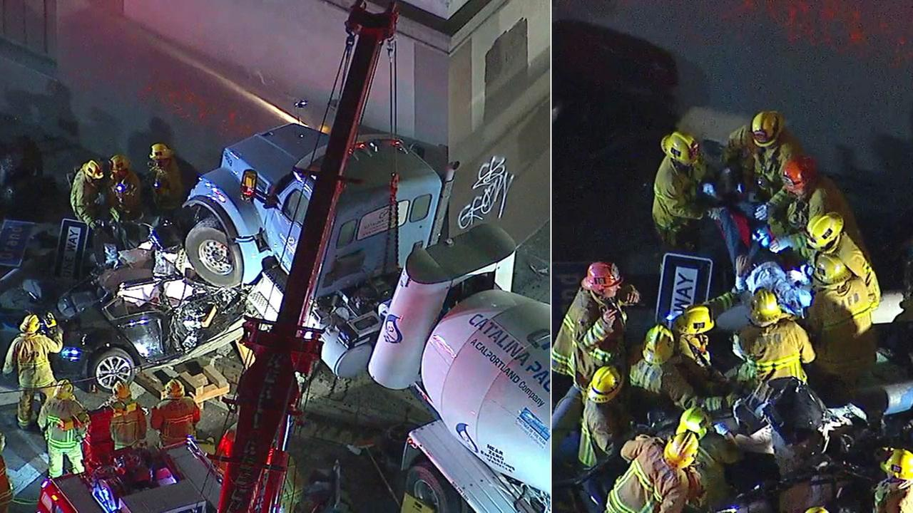 Fire crews worked to pull out a man who was trapped in his vehicle after a crash with a cement truck near downtown Los Angeles on Friday, Aug. 31, 2018.