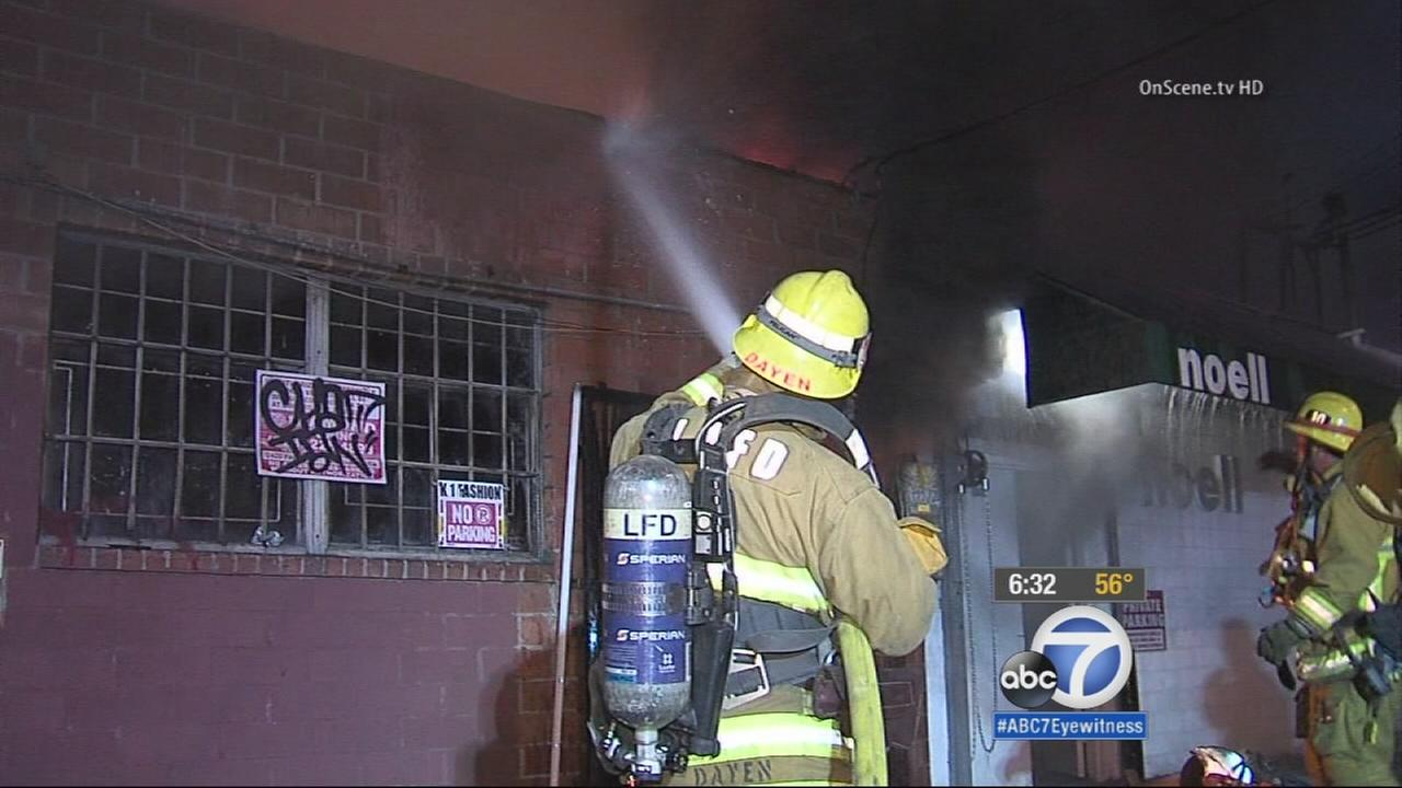 Arson investigators say a fire at a building in the garment district early Saturday morning has been deemed suspicious in nature.