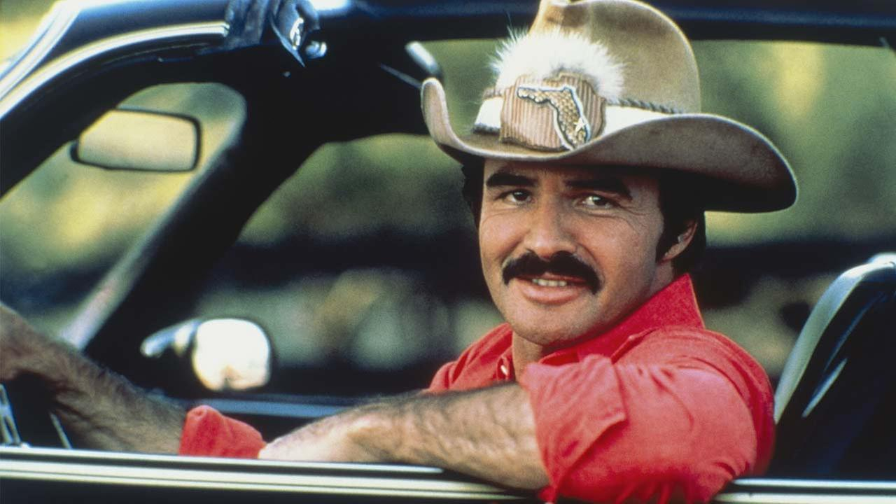 Burt Reynolds in the car from Smoky and the Bandit, circa 1970; New York.