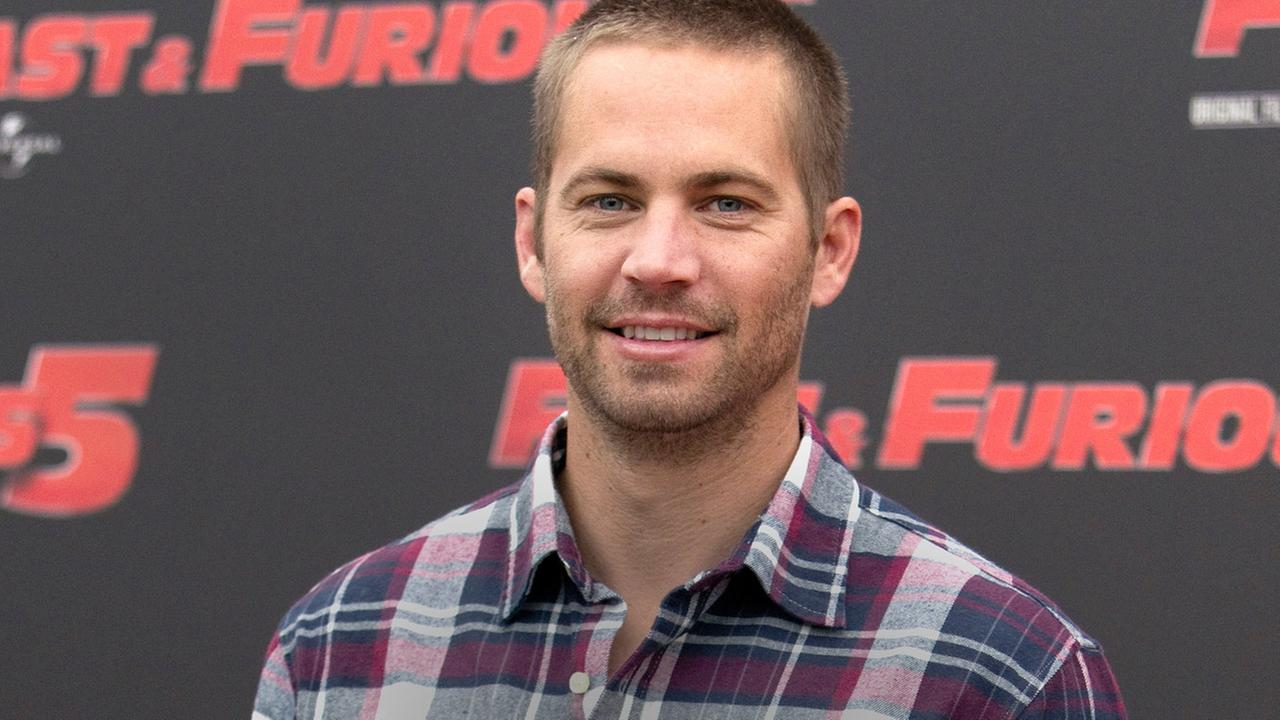 FILE - In this April 29, 2011 file photo, actor Paul Walker poses during the photo call of the movie Fast and Furious 5, in Rome.