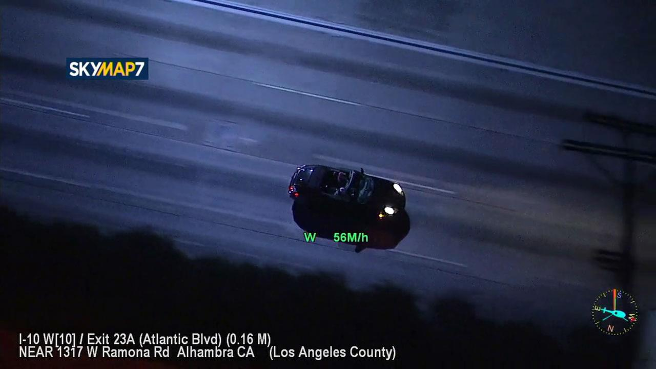 Authorities chase a black Porsche Friday night as the vehicle takes authorities across different parts of Los Angeles County.
