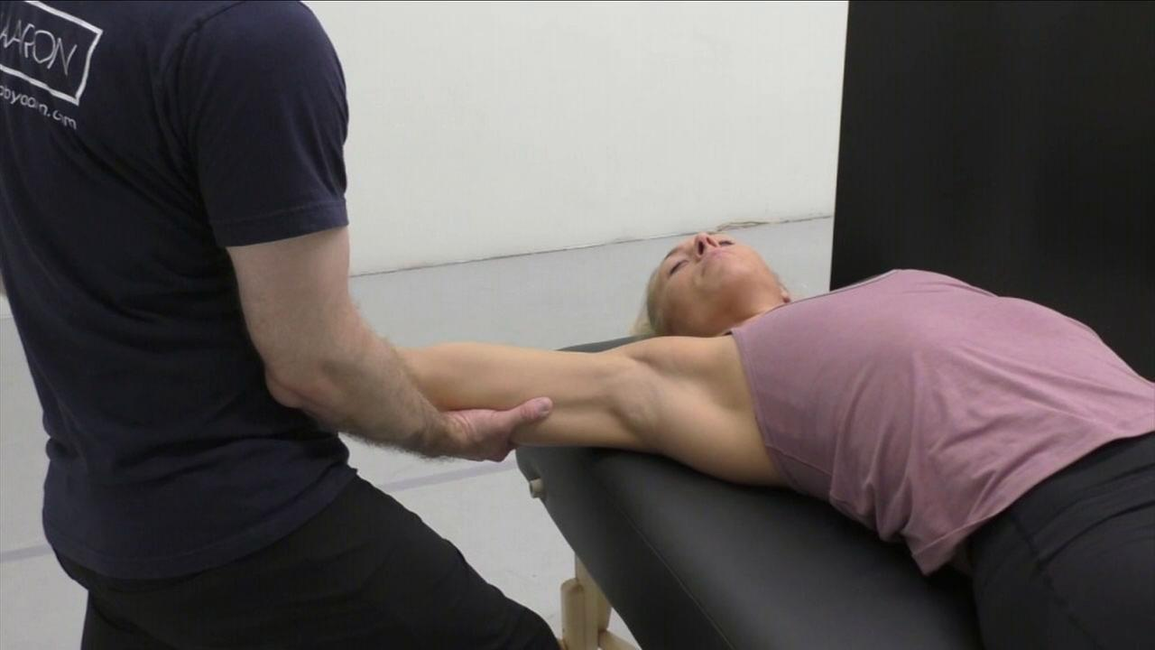 Fascial stretch therapist Aaron Porter is seen helping a client.