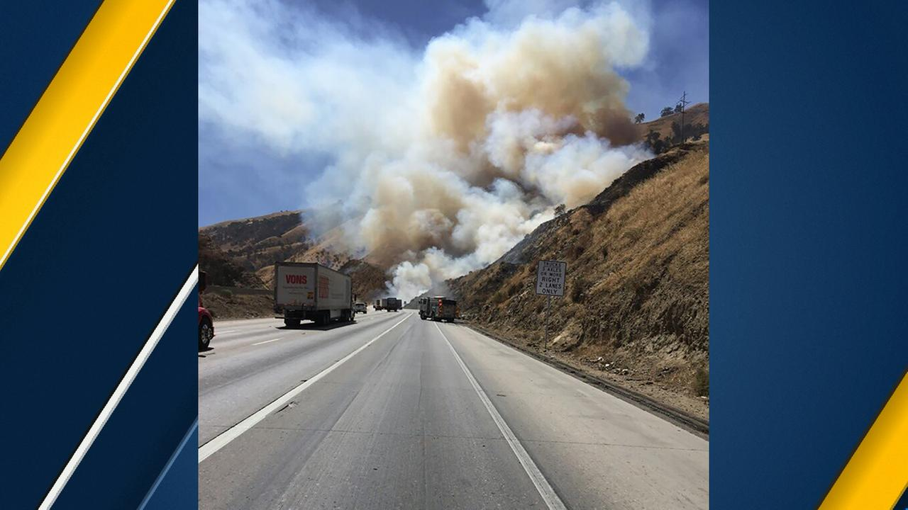Firefighters were responding to a vegetation fire that had torched as many as 40 acres near the 5 Freeway in the Grapevine, authorities said.