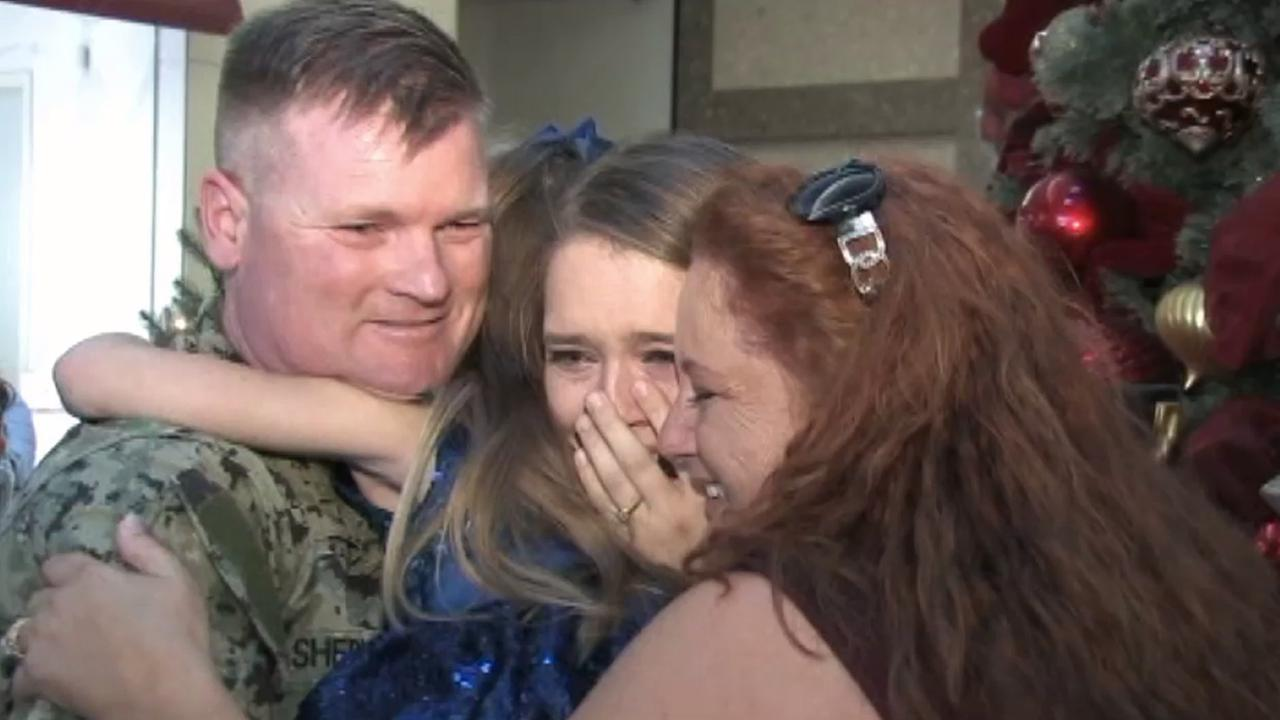 U.S. Navy Seabee Ron Sherman reunited with daughters, Madison and Jordan, and wife Angela at the Promenade Temecula on Saturday, Dec. 6, 2014.