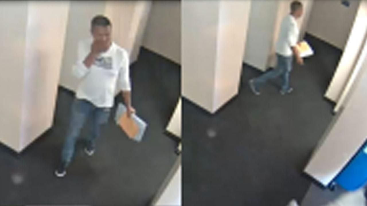 Surveillance video footage shows a man suspected of sexually assaulting a man with autism in an Orange County library bathroom on April 16, 2018.