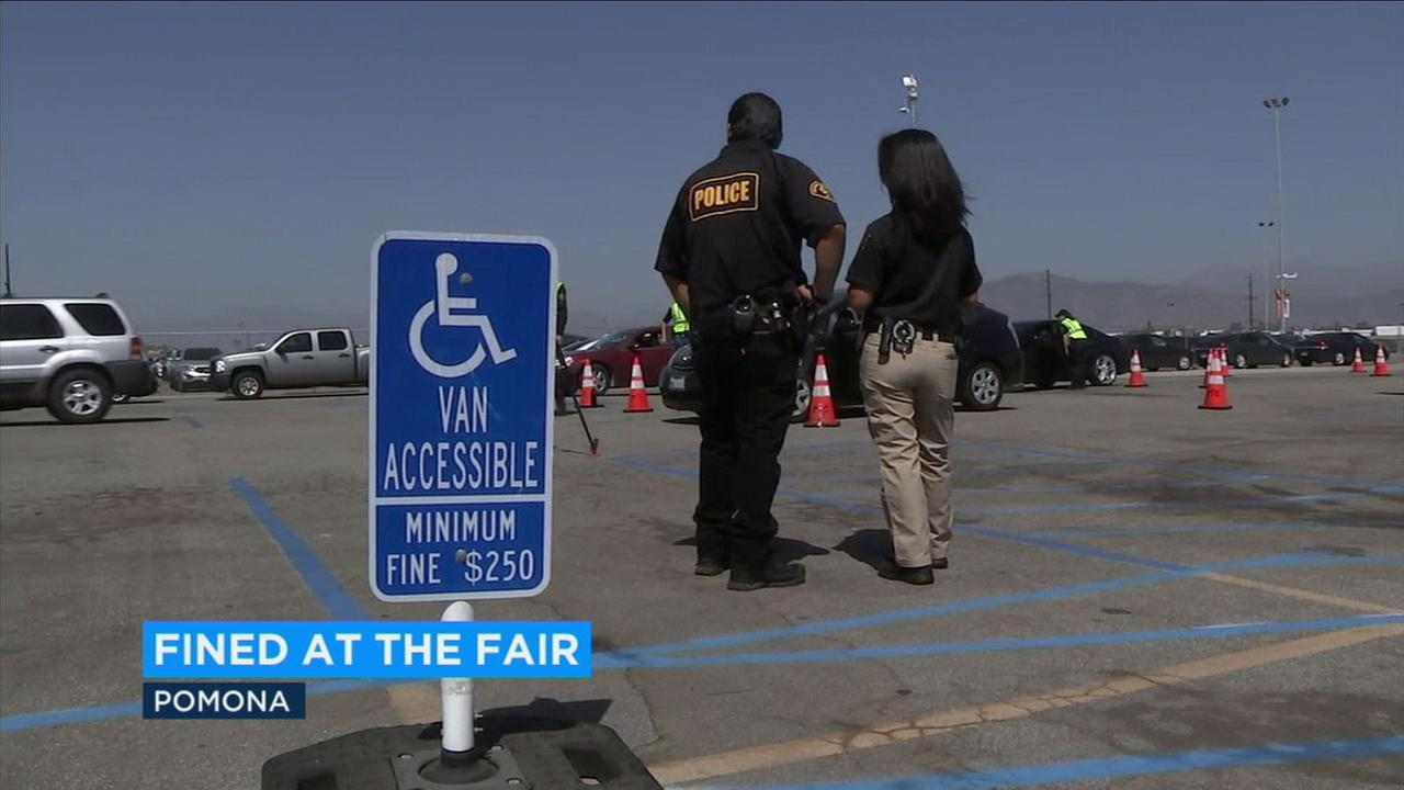 Officials are seen standing while the Department of Motor Vehicles conducted a sting operation at the L.A. County Fair.