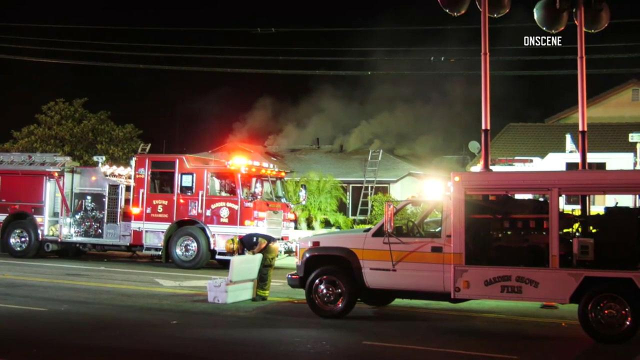 Firefighters worked on a house fire in Garden Grove Saturday night, which left two people dead.