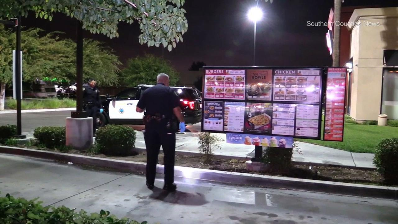 Authorities canvassed the drive-thru of a Jack in the Box in Long Beach after a man was found shot to death in the area.