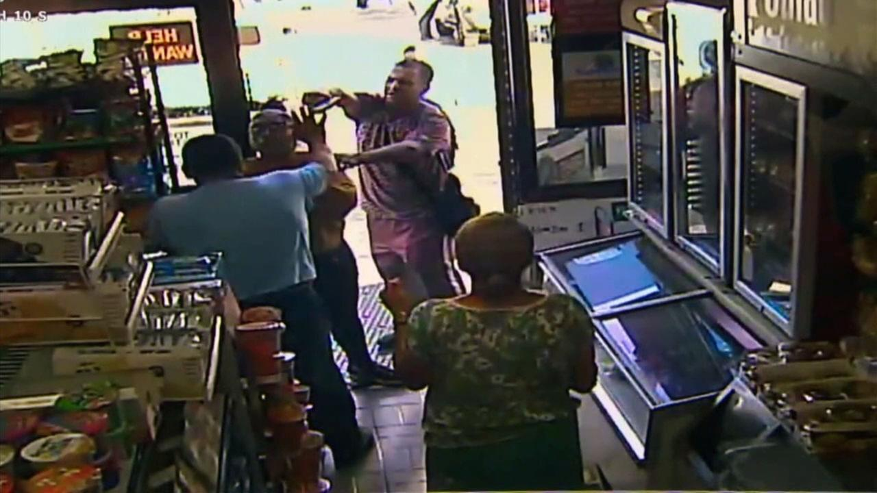 Surveillance footage shows a man with a gun at a Hollywood gas station on Wednesday, Sept. 26, 2018.