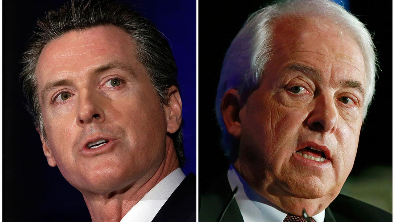 This combination of March 8, 2018 photos shows Lt. Gov. Gavin Newsom, left, and John Cox in Sacramento, Calif.