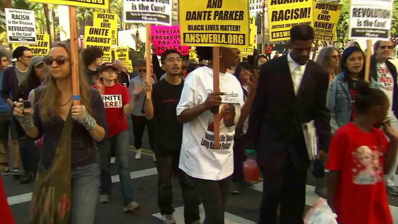 Hundreds of people gathered at Hollywood Boulevard and Highland Avenue in the latest in a series of demonstrations against police brutality Saturday, Dec. 14, 2014.