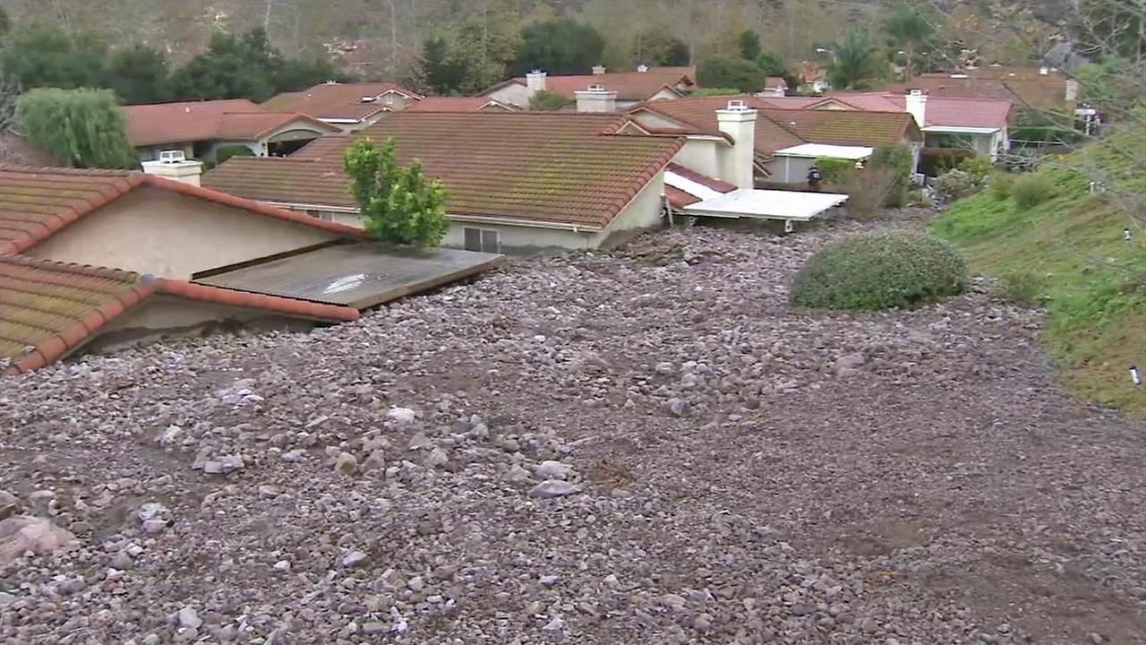 Homes in a Camarillo Springs neighborhood are seen after a mud and debris flow from a major storm Friday, Dec. 12, 2014.
