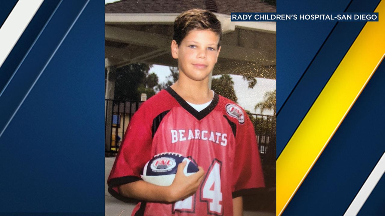 A picture of a 13-year-old boy who was airlifted to a hospital after being attacked by a shark at a beach in San Diego County.