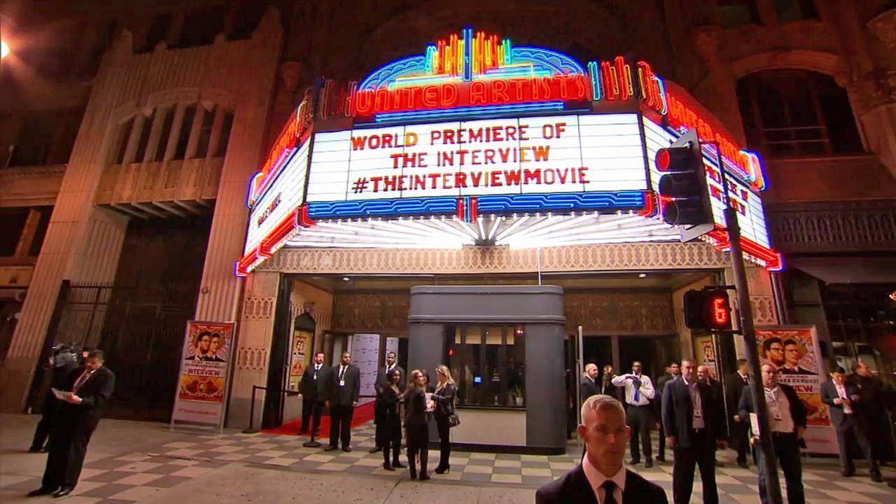 Security guards are seen outside the United Artists theater during premiere of The Interview in Los Angeles on Dec. 11, 2014.
