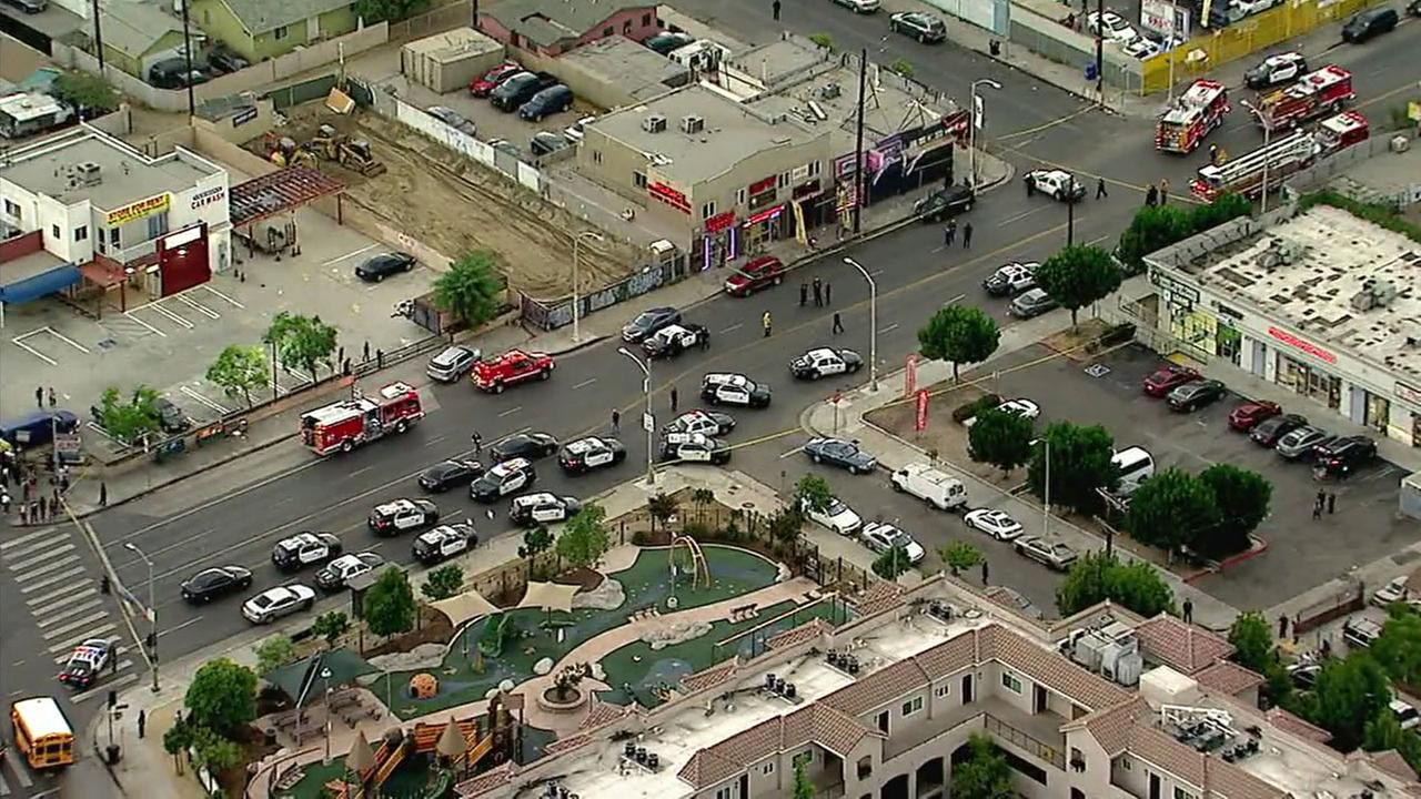Authorities surrounded an area of a reported triple shooting in South Los Angeles.