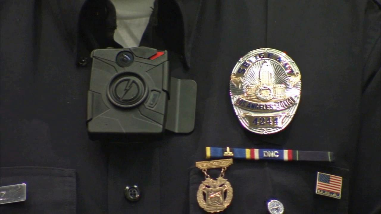 An officer with the Los Angeles Police Department is outfitted with a body camera in this undated file photo.