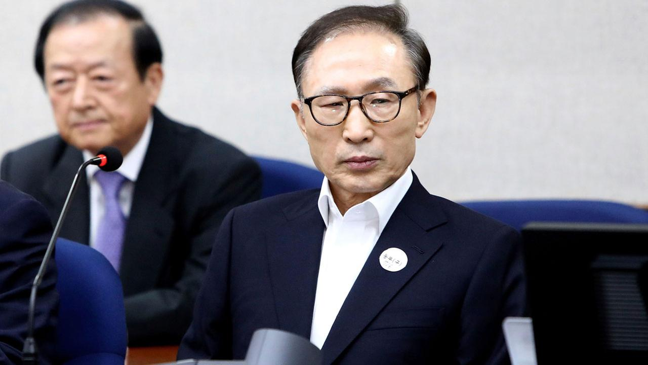 Former South Korean President Lee Myung-bak appears for his first trial at the Seoul Central District Court in Seoul Wednesday, May 23, 2018.
