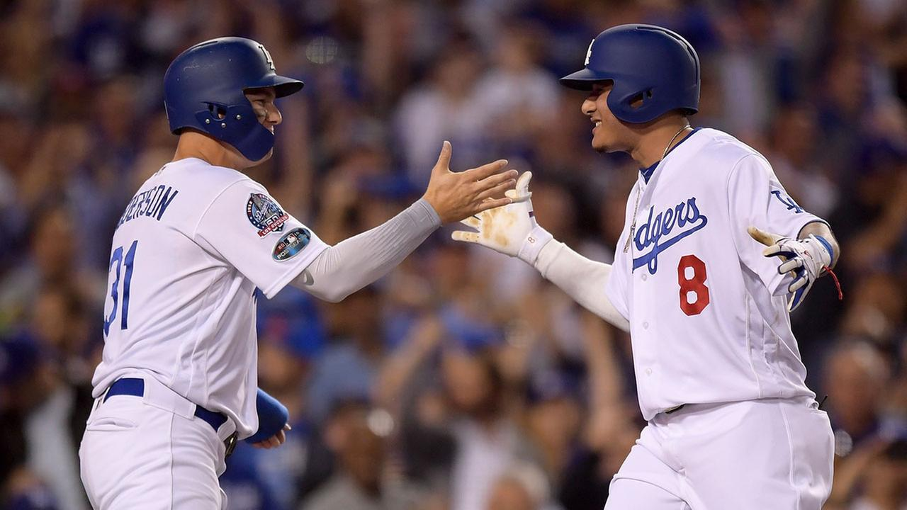 The Dodgers Manny Machado, right, celebrates his home run with Joc Pederson in Game 2 of the National League Division Series on Friday, Oct. 5, 2018.