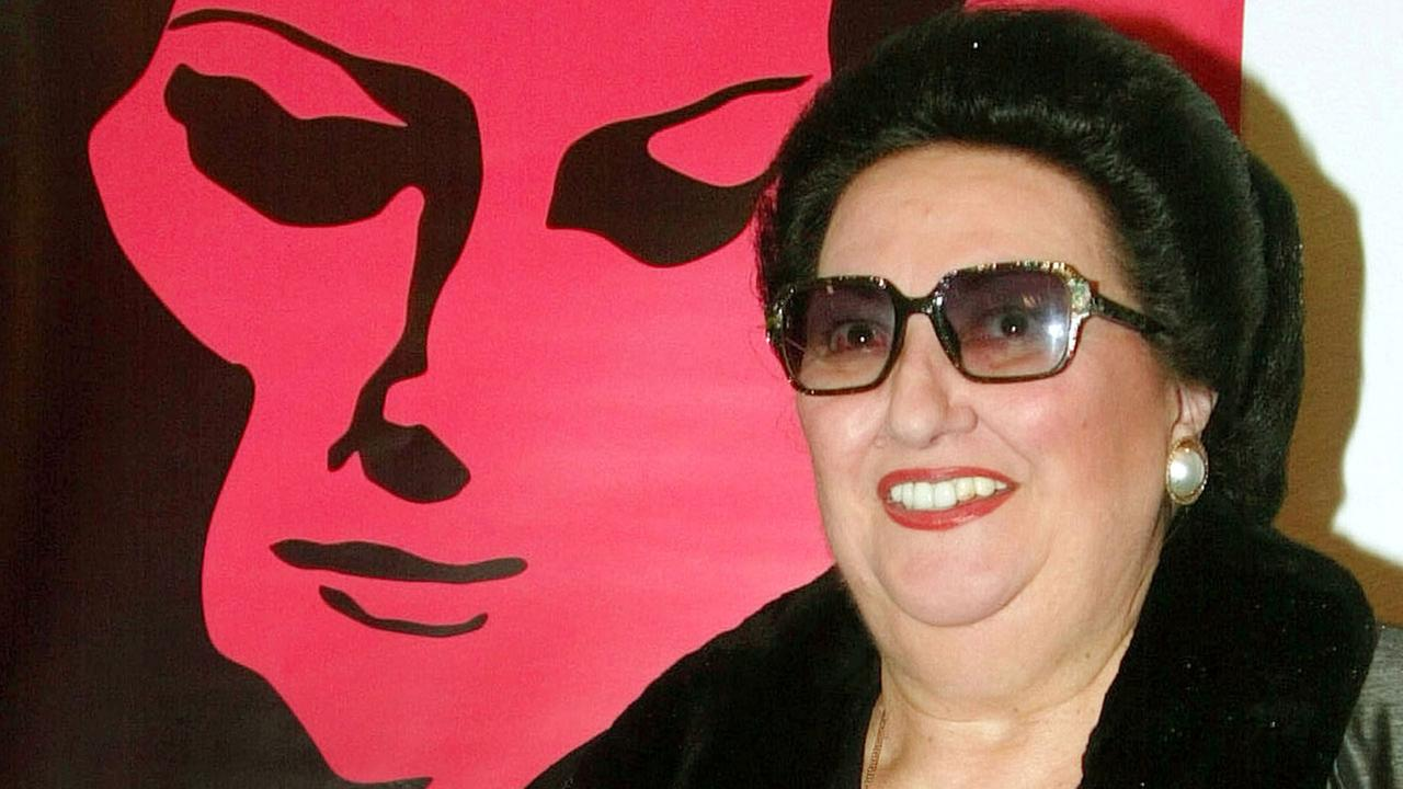 In this Tuesday Jan. 21, 2003 file photo, Spanish opera singer Monserrat Caballe poses for photographers next to the poster of Caballe Beyond Music, a movie about her life.