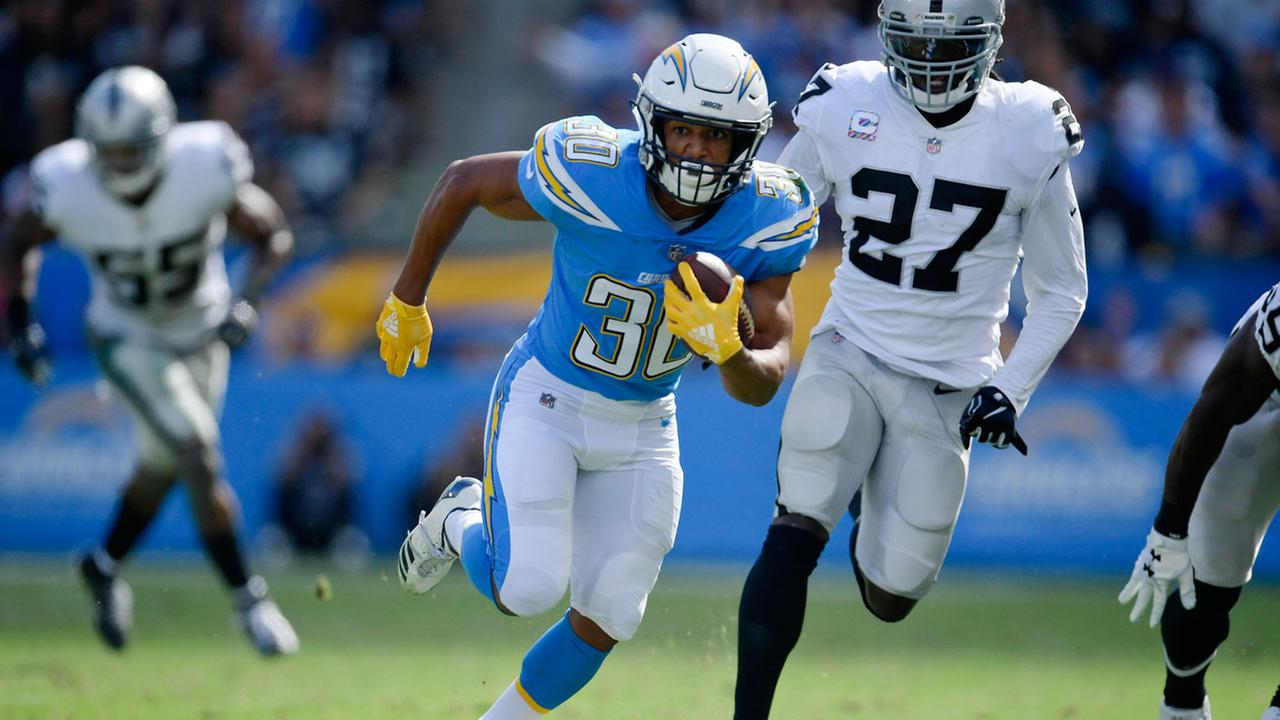 Los Angeles Chargers running back Austin Ekeler runs for a touchdown during the first half of an NFL football game against the Oakland Raiders Sunday, Oct. 7, 2018, in Carson.