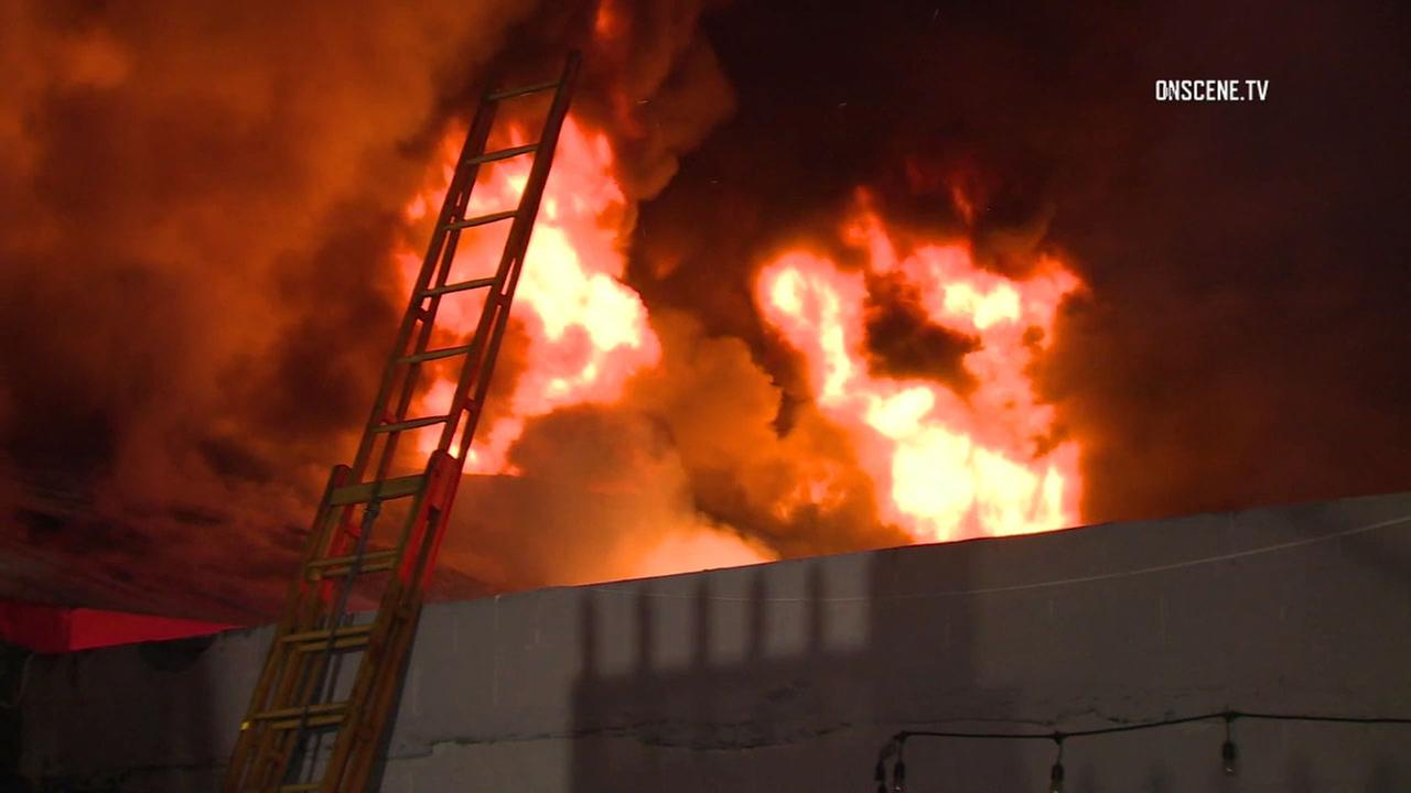 Flames erupted from the roof of a commercial building along Hooper Street in the Florence area.
