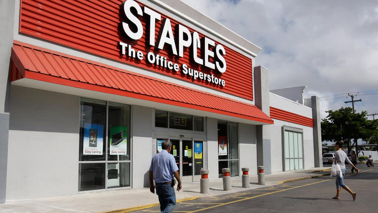 FILE - In this Nov. 15, 2011, file photo, a Staples office supply store is photographed in Miami.