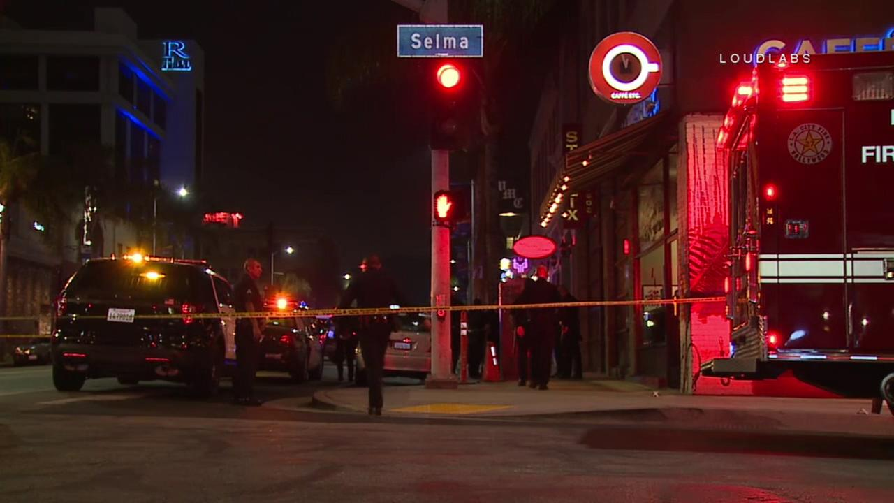 A woman was hospitalized after being shot on a street corner in Hollywood, authorities said.