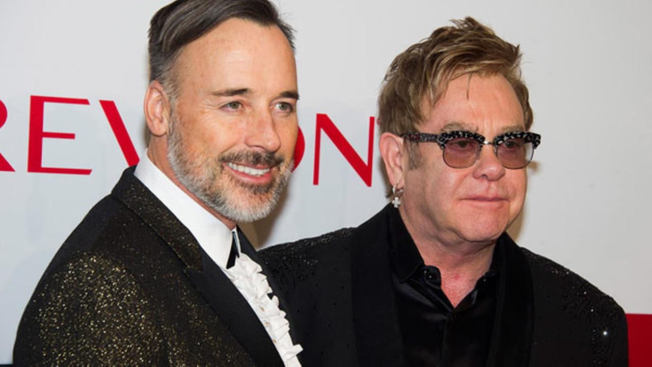 Elton John, right, and David Furnish attend the Elton John AIDS Foundations 13th Annual An Enduring Vision benefit at Ciprianis Wall Street on Tuesday, Oct. 28, 2014.