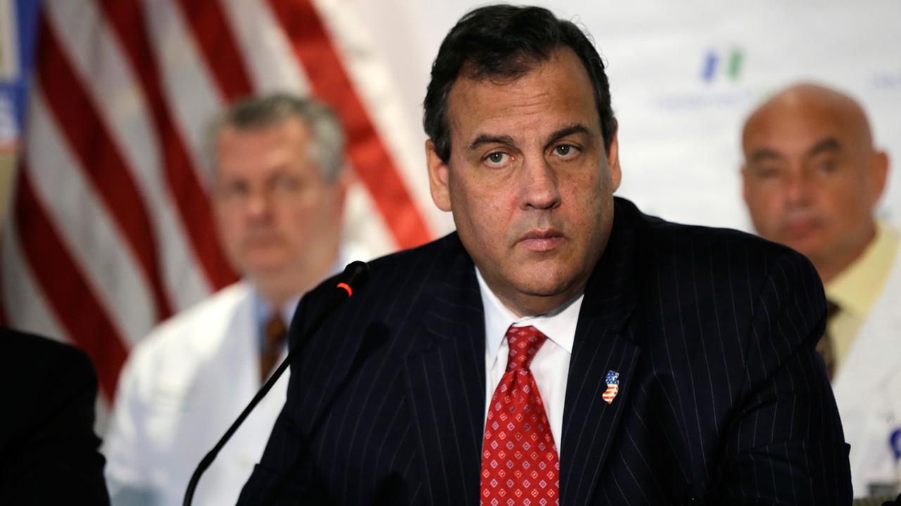 New Jersey Gov. Chris Christie listens to a question as he addresses a gathering at Hackensack University Medical Center Wednesday, Oct. 22, 2014, in Hackensack, N.J.