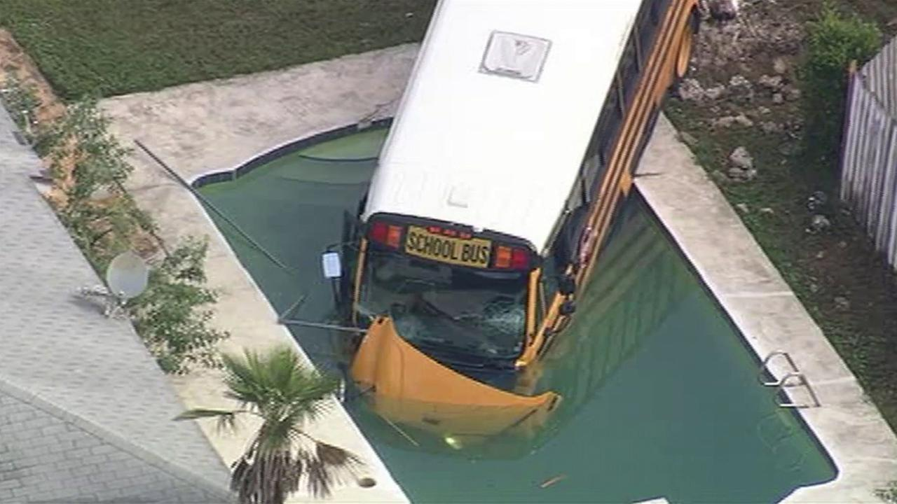 A school bus ended up partially submerged in a backyard swimming pool after a separate collision involving a Jeep outside Orlando, Florida.